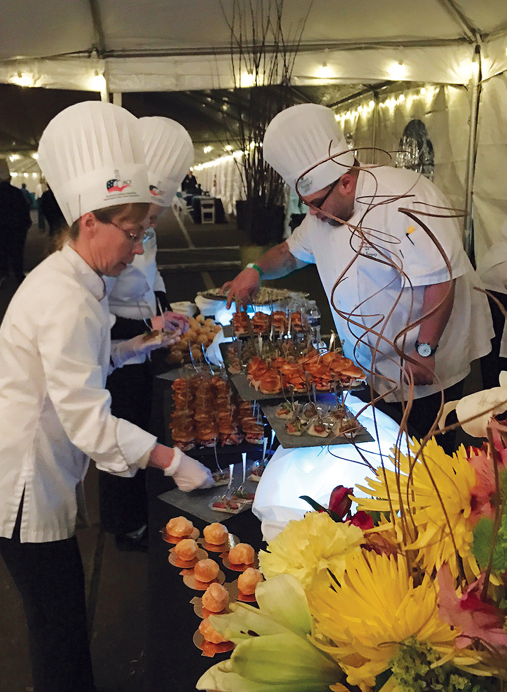 SVC Culinary Arts Chef Instructor Shawnna Poynter (left) and Department Co-Chair Gilbert Rodriguez (right) put the final touches on hors d' oeuvres prepared by SVC's Culinary team for Governor Inslee's Inaugural Ball.